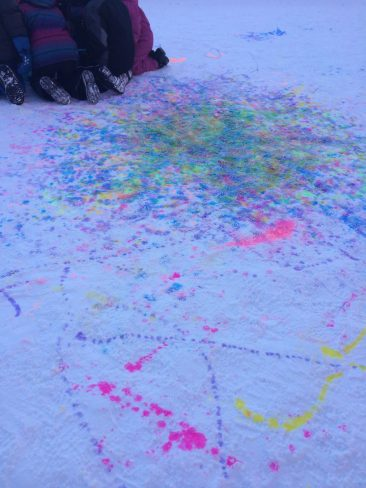 Our schoolagers painting in the snow outside